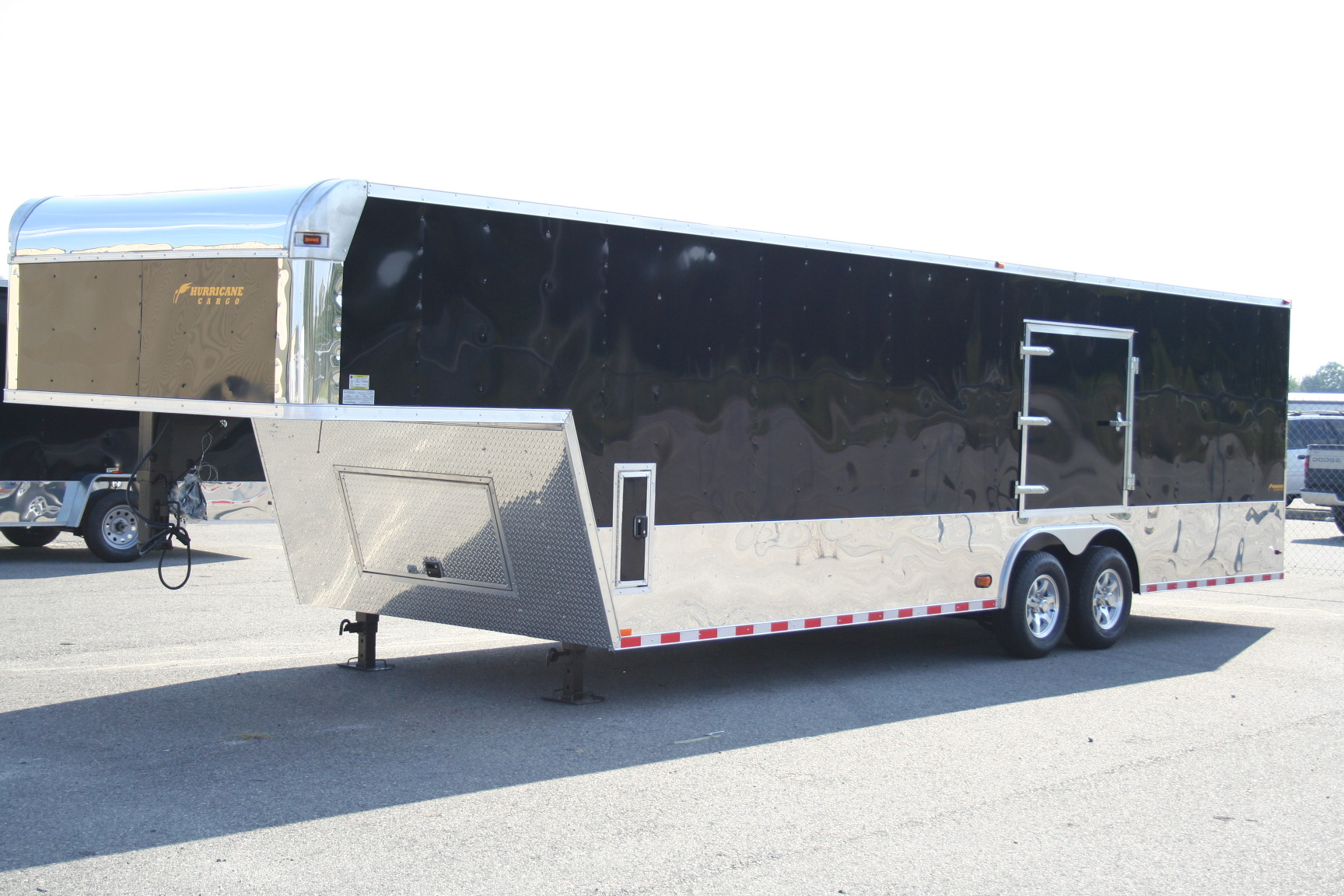 32′ Gooseneck w/Black Touring Package, Mags & Escape Door