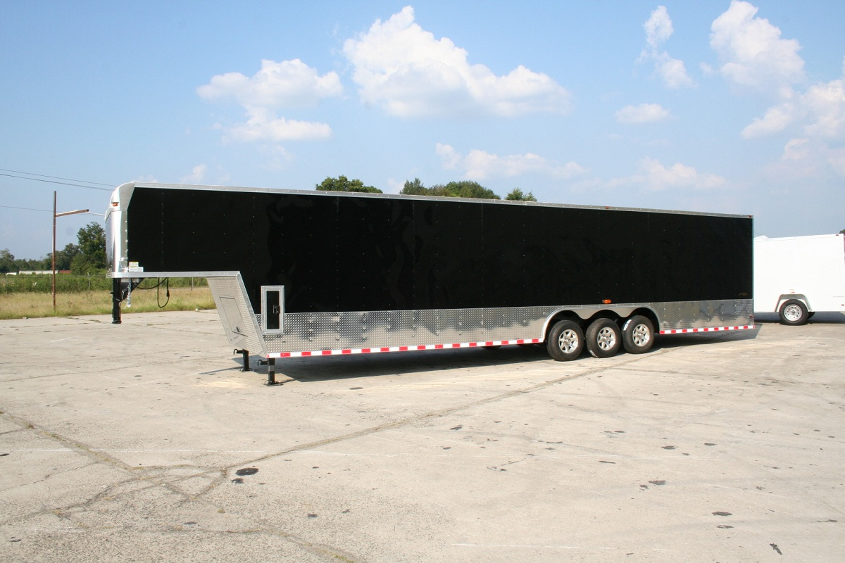8.5X44 TRIPLE AXLE ENCLOSED TWO CAR HAULER GOOSENECK TRAILER
